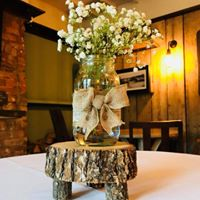Artificial wedding flower log slice centrepieces and event decoration hire. Glamour events hire based in Chester