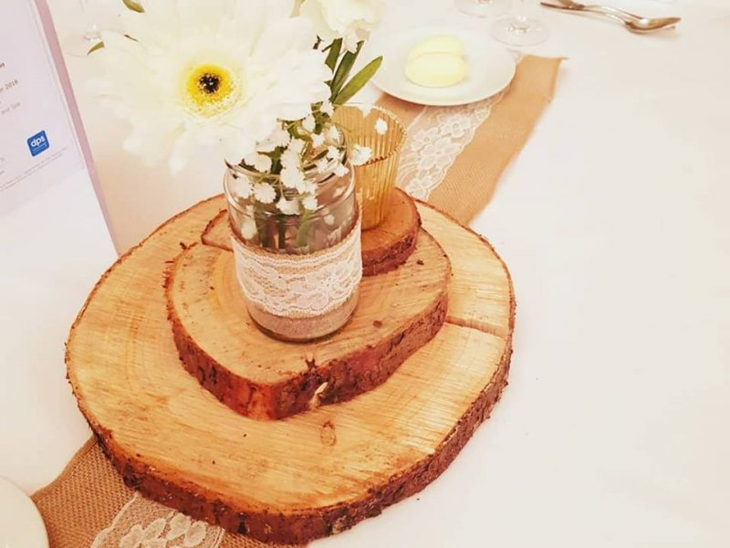 Artificial log slice wedding flower centrepieces and event decoration hire. Glamour events hire based in Chester