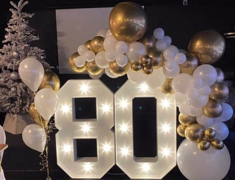 Light up numbers and letters with balloon display for 80th birthday party in chester.